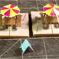Picnic Tables & Umbrellas with Dishes, Books & Signboard